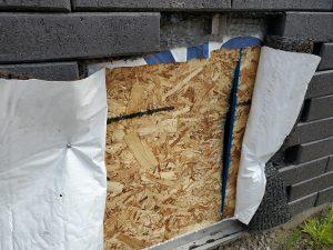 Step 5: Carefully cut the drainage met and Tyvek so it can be re-sealed and attached.
